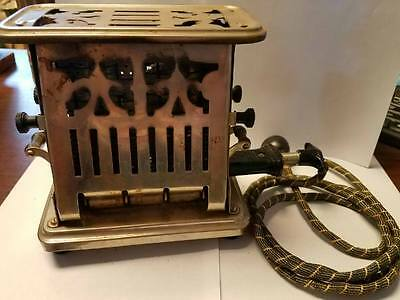 Vintage Universal Landers Frary & Clark Flip Side Toaster No. E 9412 it WORKS