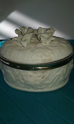Vintage white ceramic oval trinket box with gold trim and raised floral design