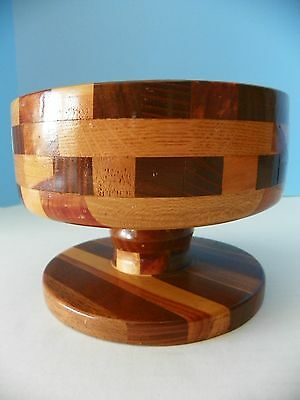 Retro wooden hand crafted nut bowl on pedestal