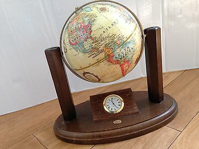 Small World Globe On Hardwood Stand And A Small Center Piece Clock