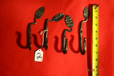 Lot of 4 hand forged wall hooks, whith decorative leaf.