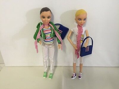2 Spin master liv dolls, with clothes and shoes.