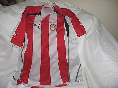 Olympiakos home shirt.Free UK delivery