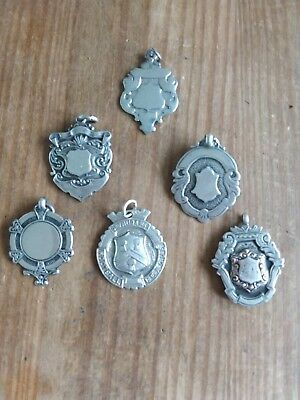Solid silver watch fobs