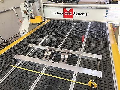 Pro Tech Machinery hold down system for flat table CNC Routers no vacuum needed
