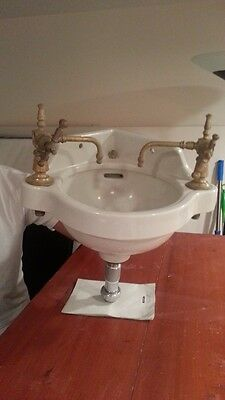 Antique corner porcelain bathroom sink, faucets and curtain
