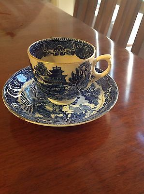 blue and white cup and saucer  very old