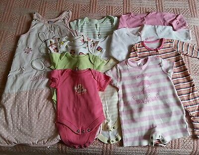 Sleeping bag, sleepsuit, 3 babygrows,  and 7 vests for a girl 0-3 months