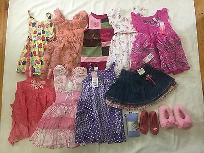 12 Items of girl's clothing, 9 dresses size 1, 1 dress size 2, 2 shoes + tights.