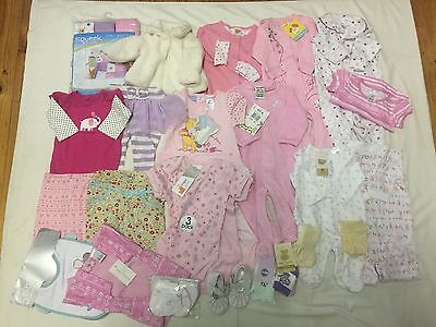 20 Items of baby wear for girl's. Size 000,00,0, plus shoes and socks and rugs.