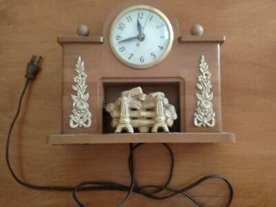 Beautiful vintage United Light up fireplace clock