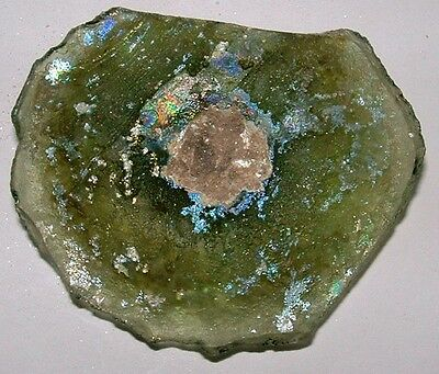 ancient roman glass fragment with  nice patina amazing.  nice color.