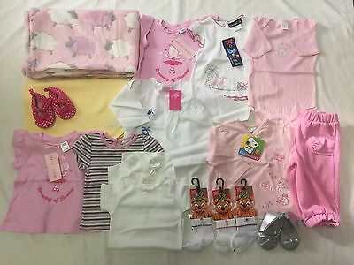 15 Items for a baby girl, mainly size 0. Clothes, shoes, bunny rugs, socks.