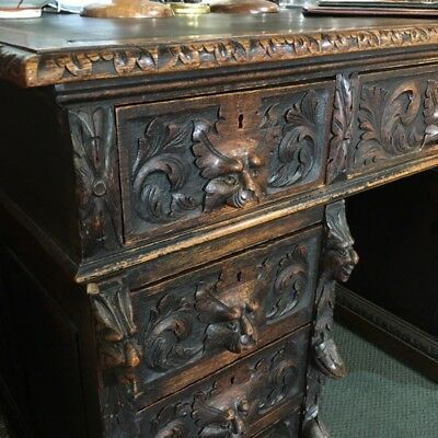 English oak desk with heavy 'Elizabethan' carving, c. 1870