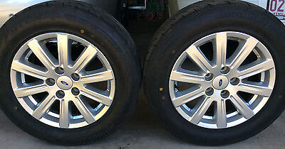 Ford Fairmont.  4 alloy wheels and tyres