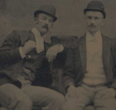 Portrait Of Two Young Men In Bowler Hats Smoking Cigars
