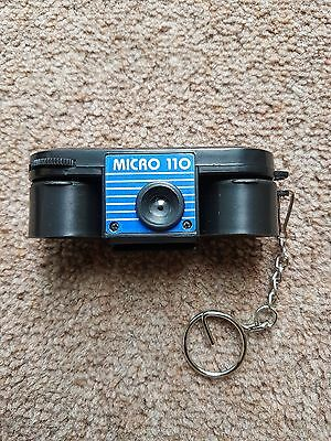Vintage Micro 110 Palm Sized Camera in box with key chain and instructions.