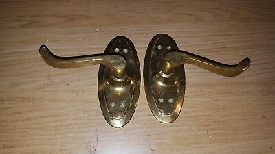 Vintage pair of brass door handles