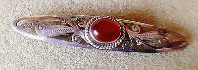 Solid silver and amber brooch