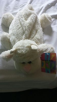 Hot water bottle with cosy lamb soft toy cover