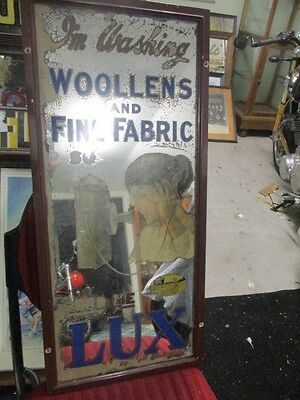100 year old lux advertising mirror```````RARE