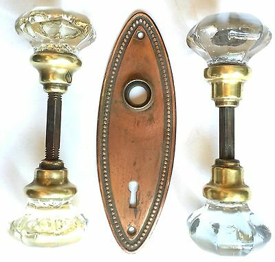 Four Original Antique Glass Doorknobs With Brass Caps, Stems And Back Plate