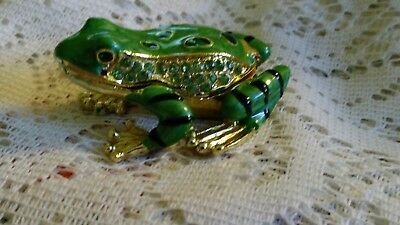 Jeweled tree frog hinged trinket box figurine with a dragonfly in his belly.