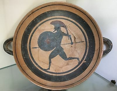 Greek Drinking Cup...The KYLIX....c. 550 BC.....Warrior Scene