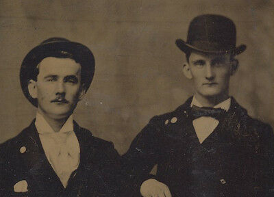 Portrait Of Two Affectionate Young Men In Bowler Hats