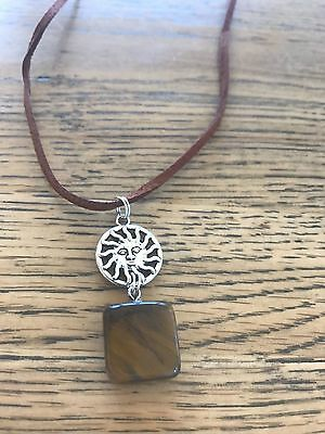 Tigers eye natural stone with Sun face pendant brown suede necklace