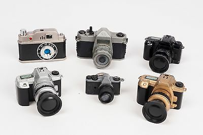 Collection of camera lighters, magnet  and Sevilla souvenir views camera