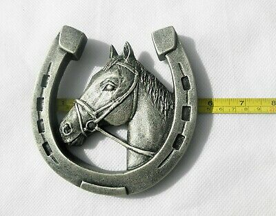 Horseshoe with a horse for happiness, horse head