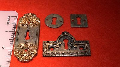 eschutcheon plates, four, decorative and plain, two new, two old,