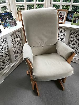 Dutailier Glider chair upholstered in soft cream fabric excellent condition