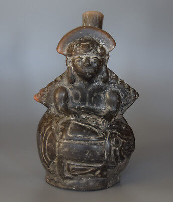 Pre-Columbian Chimu Blackware Vessel In The Form Of A Figure Fishing