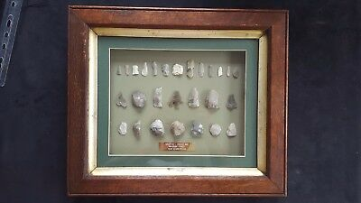 Collection of framed Neolithic microliths, blades, and tools. Wykeham Forest