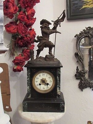 Antique French superb old mantle clock with a musketeer !