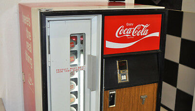 1974 Coca Cola machine in working order. this won't last long.  machine has been