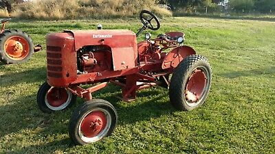 Earthmaster model C antique tractor with sickle parts