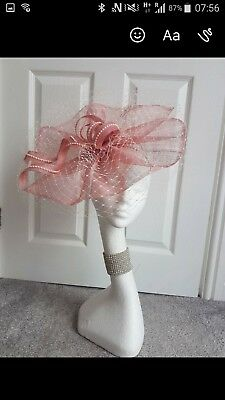 pink fascinater brand new never worn, white lace and bow detail and pearls