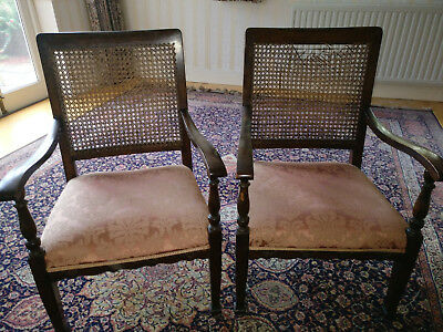 Elegant pair upholstered arm chairs with wicker backs