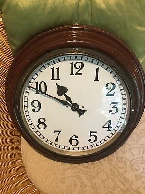 Electric Wall Clock, 70 years plus, 17 inches diameter.