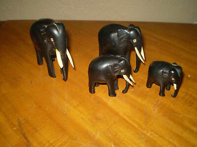 Hand Carved Wooden Elephants ( lot of four )