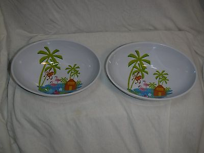 Pair of oval soup bowels with flamingo pattern inside
