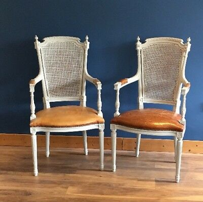 A Pair Of French Open Armchairs With Leather  Seats