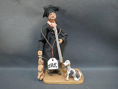 Antique santon in earth bellboy with his / her dog and a hare or rabbit