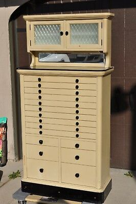 Antique dental cabinet 16 drawer with top hutch by American cabinet company