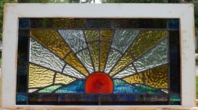 Arts and crafts sunrise leaded stained glass window