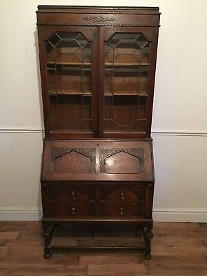 1930s oak carved bureau bookcase with leaded doors