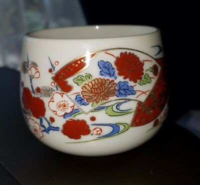 Vintage Japanese Sake tea cups in red, blue, white and gold